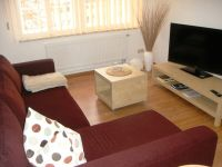 Old string factory - red apartment 3 - Comfortable sofa can serve as extra bed in the living area