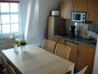 Old string factory - red apartment 3 - kitchenette and dining area with extensive equipment